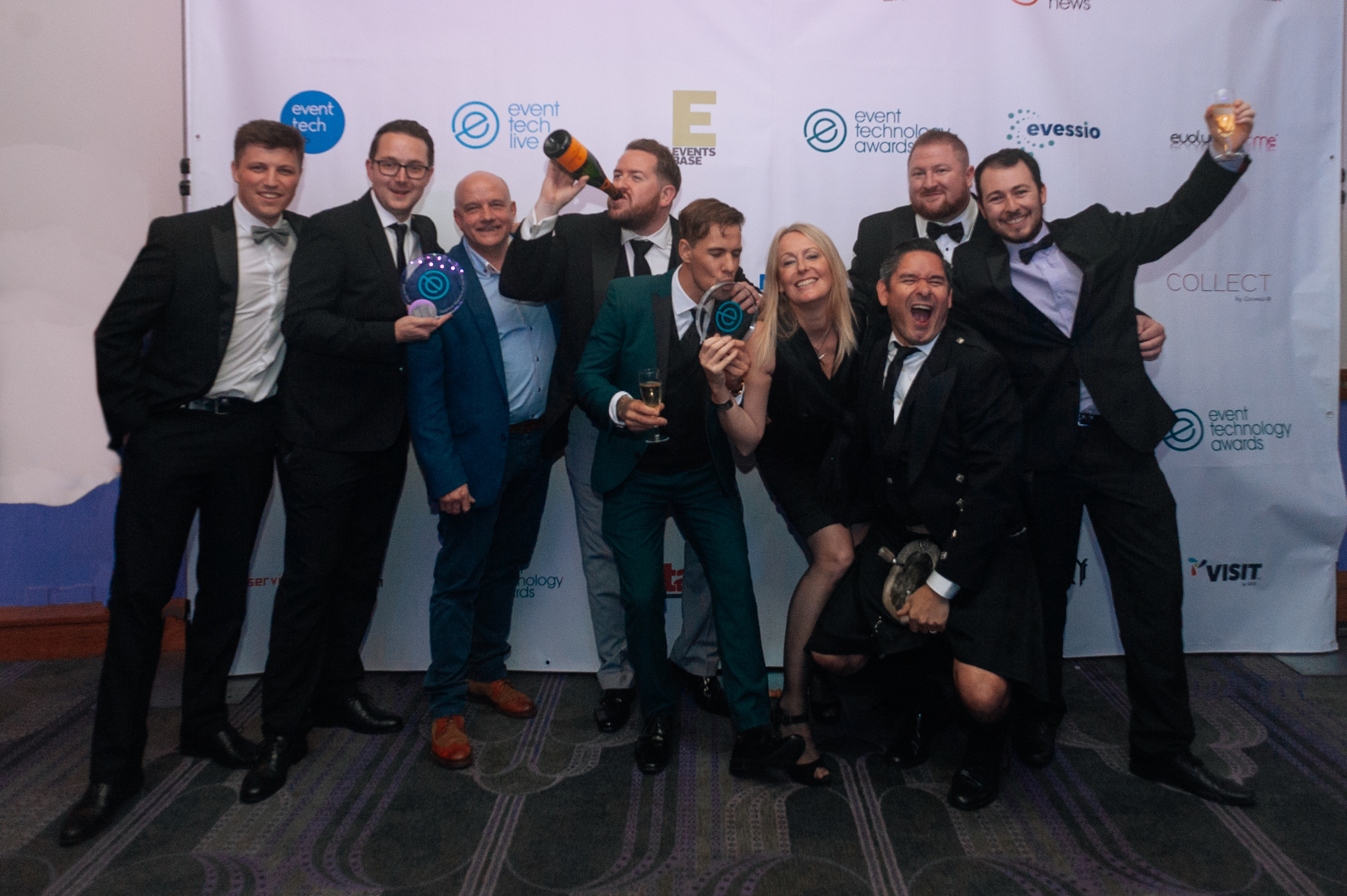 group celebrating event technology award win